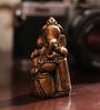 Aapno Rajasthan Brown Resin Beautiful Ganesha Idol Showpiece Sitting on Tabla