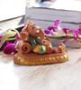 Aapno Rajasthan Pink & Brown Terracotta Sofa Ganesh Showpiece