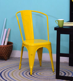 Kangra Metal Chair in Yellow Colour by Bohemiana at pepperfry