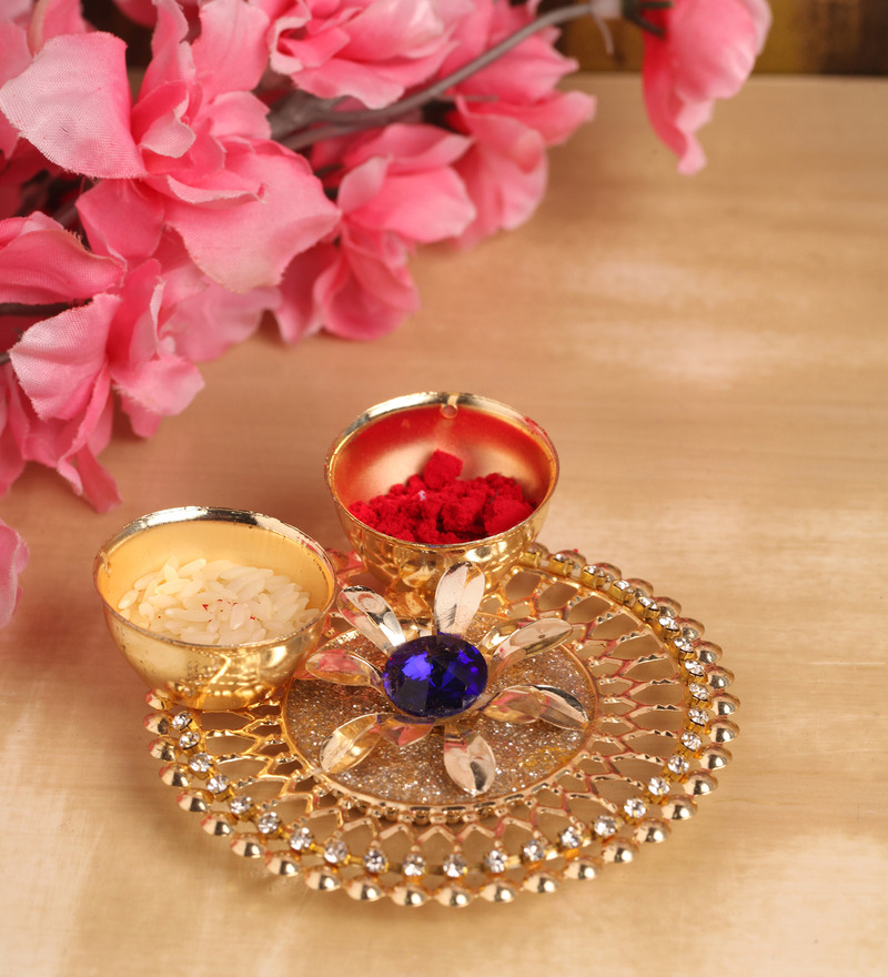 Itiha Golden Metal Decorative Floral Haldi Kumkum Holder  available at Pepperfry for Rs.175