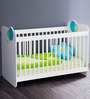 McCyan Baby Crib Bed with Adjustable Height in White Finish by Mollycoddle