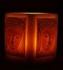 Resonance Carved Buddha Face Orange Candle