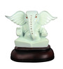 The Nodding Head White Polyresin Sitting Lord Ganesha Idol