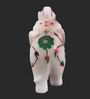 The Nodding Head White Stoneware Trunk Up Elephant with Green & Blue Flowers Showpiece
